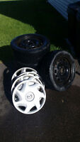 4 BLACK RIMS WITH 4 USED BF GOODRICH WINTER SLALOM TIRES