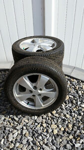 Set of Good Year All Season P205/55R16 tires on Cavalier wheels
