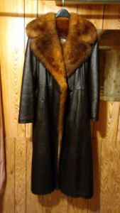 Leather coat with real fur collar