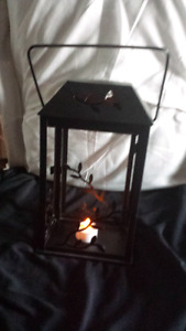 Steel lantern with a flame less tea light