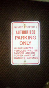 Metal sign authorized parking only