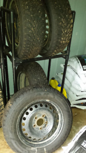 Goodyear Nordic Studded winter tires on wheels