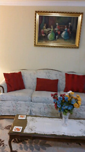 Two sofas with wood frame