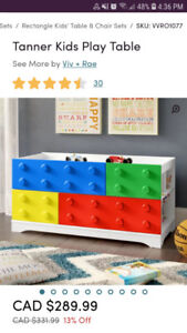 play table with storage shelves on sides