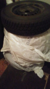 selling 4 snow tires and rims $400
