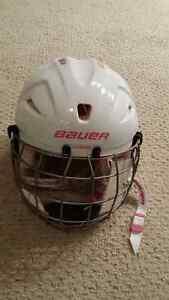 Girls hockey helmet with cage