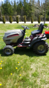 "White Lawn Tractor with 54"" deck and 46"" snowblower attachment"