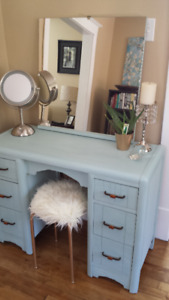 Get ready in style with this antique vanity!