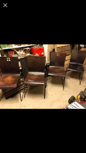 4 Modern Solid wood chairs with metal legs. All 4 chairs $60.00.