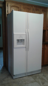 Side by side whirlpool refrigerator with ice maker