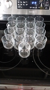 17 little glass cuos, or tealight holders.