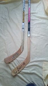 Autographed hockey sticks - Lemieux and Lindros