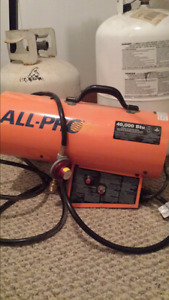 All Pro forced air heater with 2 propane tanks