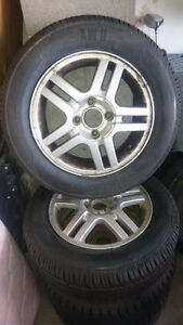 2 snow tires/2 all seasons off ford focus