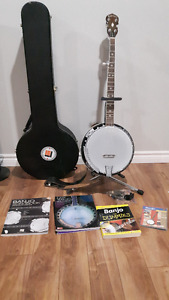 Gold tone banjo for sale with lots of accessories.