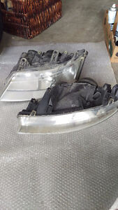 Saab 93 front headlight assemblies, with Xenon light bulbs.