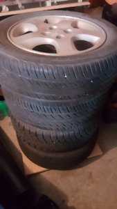 "Four Mazda 15"" aluminum rims with tires"