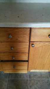 REDUCED PRICE.  SOLID OAK KITCHEN CABINETS.
