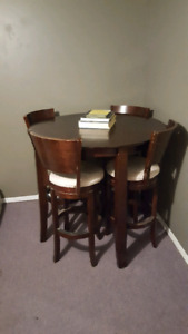 High Round Table with 4  Swivel Bar Stools