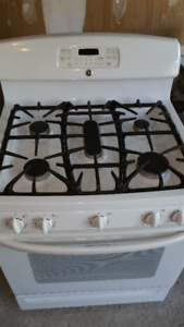 White GE self-cleaning gas range in excellent condition