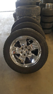 4 20inch gmc wheels with tires.