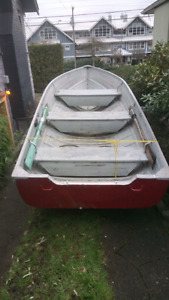 14 foot tin boat and trailer.
