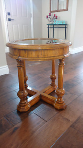 Solid wood round side table with glass top