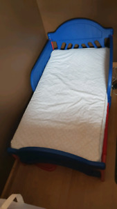 Toddler bed with mattress and mattress protector