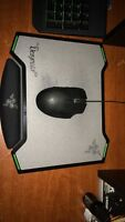 Gaming mouse and mouse pad! Only used for a month!