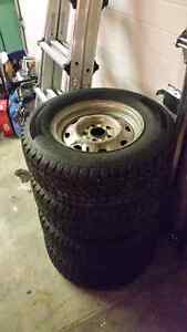 Studded Winter Tires 215/70R14 on 5 bolt Ford rims Prince George British Columbia image 4
