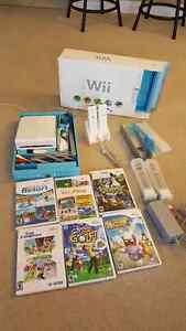Perfectly working Nintendo Wii with box and games