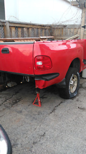 Truck box with frame to build trailer