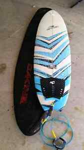 Surfboard,  bag, fins,  and leash
