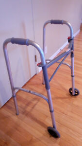 """Two button folding walker with 5"""" wheels, Gently Used"""