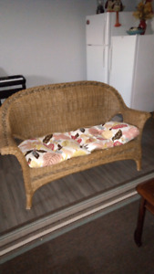 Wicker loveseat and cushion