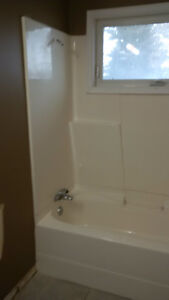 White fiberglass tub and shower enclosure