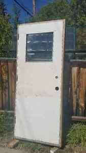 "Used Wooden Entrance Door; 32x80"" for 2x4 walls, RH inswing"