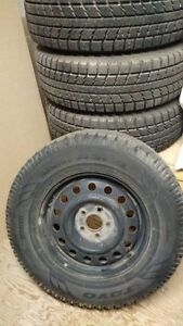 4 TOYO winter tires with rims for sale - 235/70R16 106s - $ 350 Gatineau Ottawa / Gatineau Area image 1