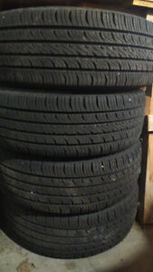 4 new all season hankook tires on rims 185 65 14