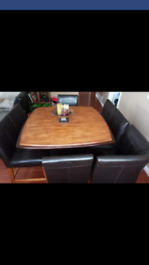 8 piece two tone light and dark solid wood table.