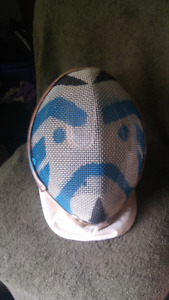 Fencing mask with facial design