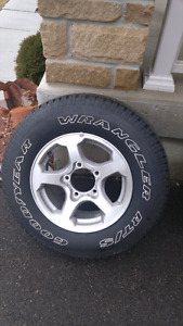 New Goodyear. Wrangler tire and rim 215 75 r15