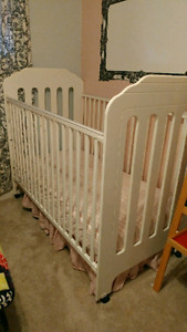 White crib and change table