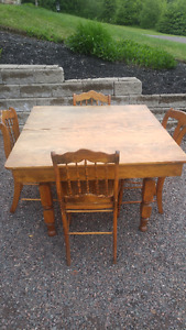 Solid maple table and cane seat chairs