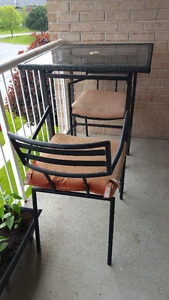 Bar height patio table + 2 chairs and cushions. $150 OBO