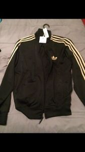 Brand new adidas tracksuit black/gold