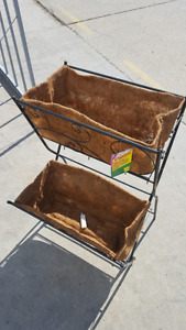 33 inch two tier metal plant stand. Coconut fiber.