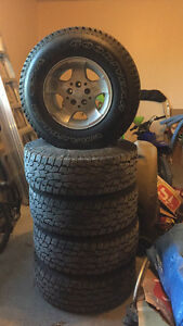 Jeep Sahara TJ rims,tires, and including spare.