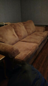 Brown three seater couch
