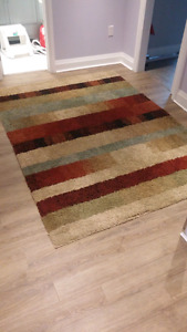 Plush patterned area rug with matching door rug